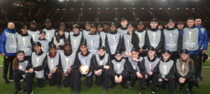 Pupils take centre pitch at Manchester United's Europa League Game
